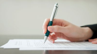 A school official drafts a 504 plan following an evaluation.