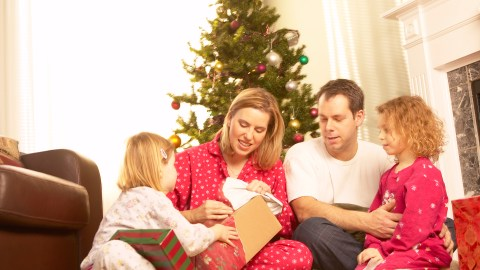 Family sitting around the tree during the holidays and talking about stress relief