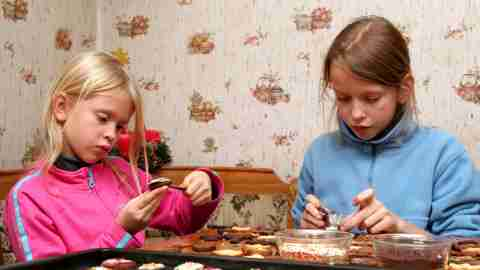 Children baking cookies during the holidays to promote stress relief