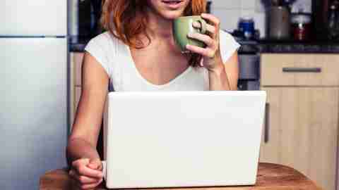 Woman looking up stress relief strategies during the holidays