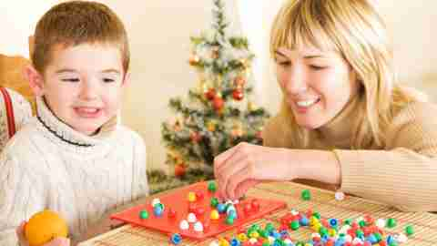 Parent playing game with a child to relieve stress during the holidays