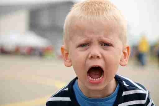 A little boy with oppositional defiant disorder ODD screams at the airport. He may need anger management for kids.
