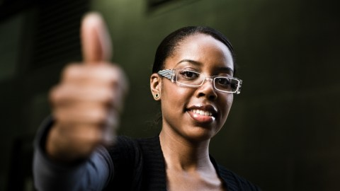 Woman giving thumbs up to easily distracted readers