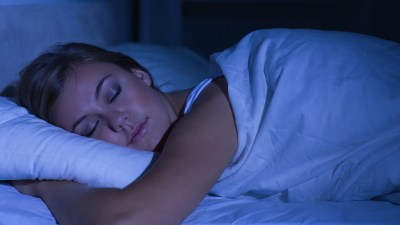 A woman with ADHD sleeping peacefully after establishing a healthy bedtime routine