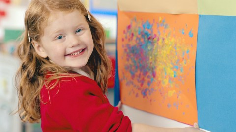 Girl paints to use her strengths. ADHD doesn't make someone stupid, just different.