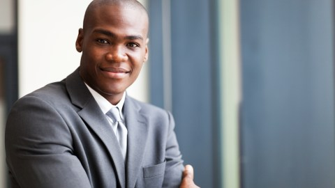 A businessman looks confident because he knows how to succeed with ADHD at work.