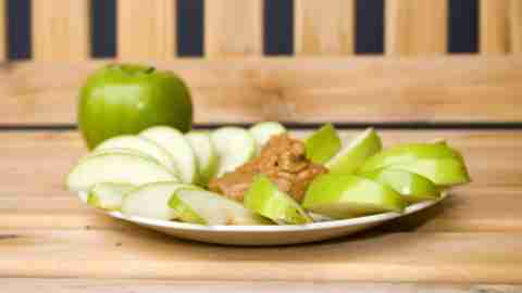 An apple with nut butter, an example of an ADHD recipe that is high in protein