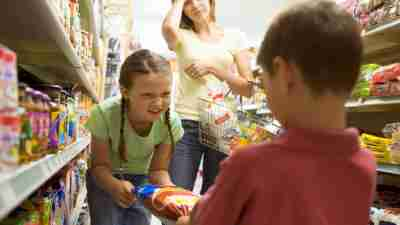 A mom of two children with ADHD arguing in the grocery store