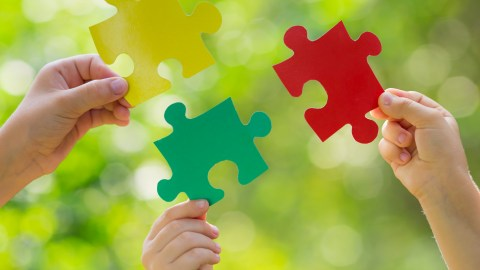 Puzzle pieces that fit together are a metaphor for piecing together symptoms of autism spectrum disorder.