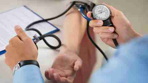 A doctor takes a patient's blood pressure to determine if she is prescribed the correct dose of Adderall.