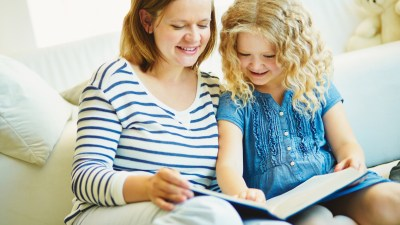 A mother and daughter reading an ADHD parenting book together