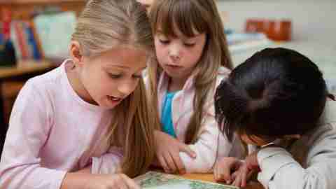A child playing with her friends, which should be a topic of discussion on any back-to-school list.