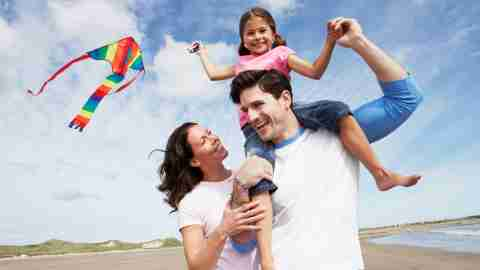 A family vacations happily at the beach. Their daughter's ADHD drug holiday is a success.