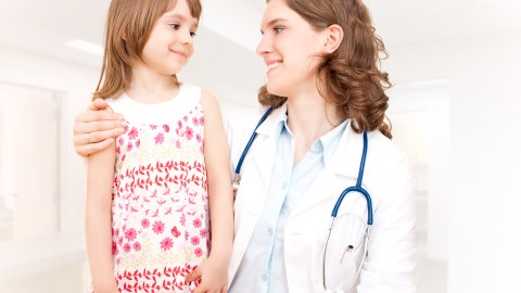 A little girl is assessed by her doctor after taking an ADHD drug holiday.