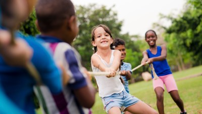 Children playing tug-of-war at a summer camp for kids with ADHD