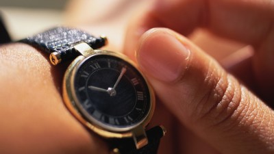 Close up of person with ADHD adjusting their wrist watch to better manage their time