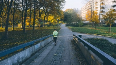 Person with ADHD working out by running in Autumn