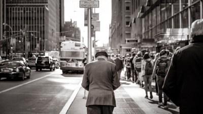 Man with ADHD walking through crowded city street