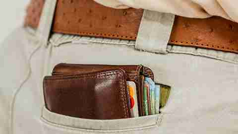 Man with ADHD shown with wallet sticking out of back pocket