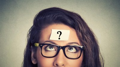 Woman with question mark on her head wonders about her ADHD and its connections to learning disabilities