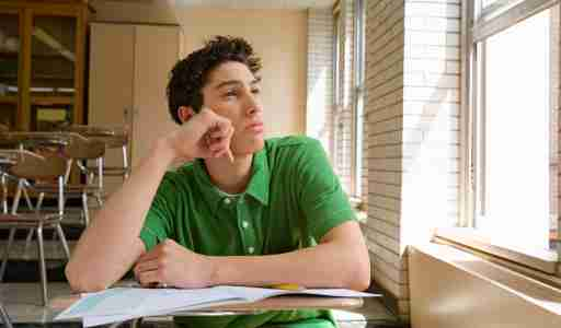Teen with ocd and adhd looking out of a window