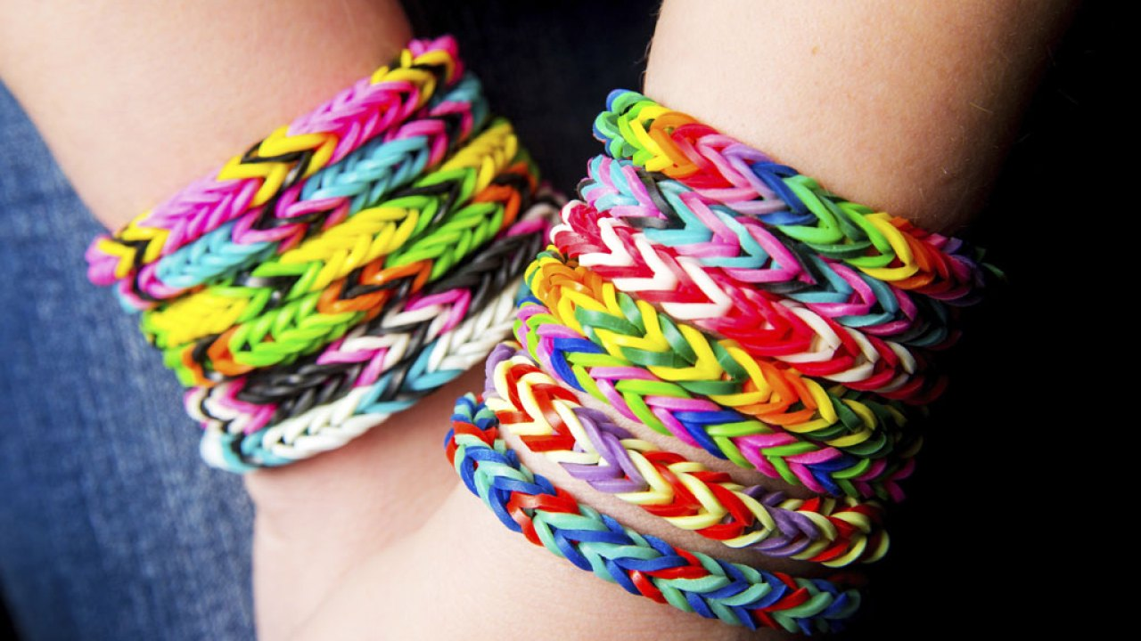 A close-up of friendship bracelets on a teen girl who knows what anxiety feels like