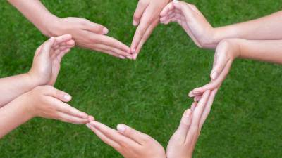 Many hands construct a heart to emphasize the positives in ADHD