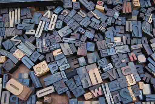 Jumbled letter print stamps used to demonstrate dyslexia and ADHD