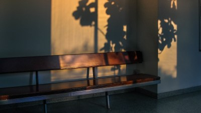 Raising a Bi-Polar Child can be Lonely, like this Bench With Light and Shadow Streaming Through Window
