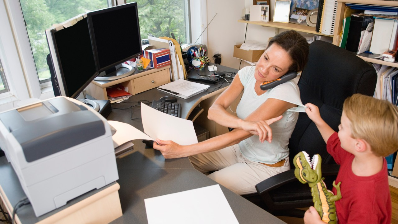 Overwhelmed working mother with ADHD at home