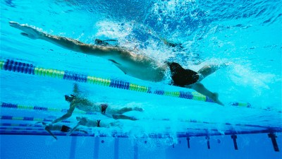 A swimmer in a pool, possibly Michael Phelps