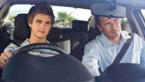 Father teaching yound ADHD teen to drive