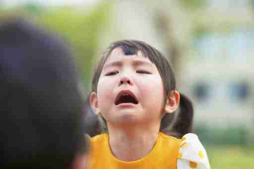 A young ADHD girl crying after her parent doled out consequences for bad behavior