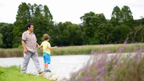 Father and son with ADHD take a weekend walk by a lake