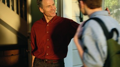 A father greets his defiant teenager at the door.