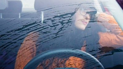 ADHD teen girl in car is distracted