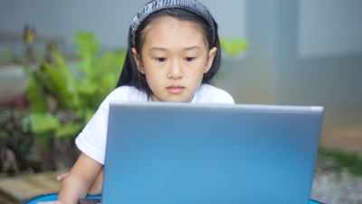 A young girl with ADHD using educational software to help her in school.