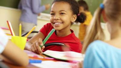 A young girl thriving in school after her parent made a request for a special education evaluation