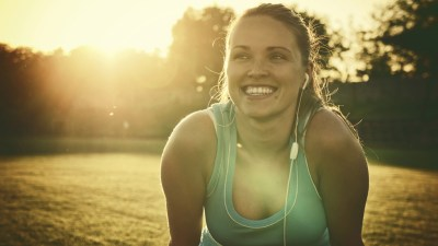 A woman smiling after a run, one of many natural treatments for ADHD in adults