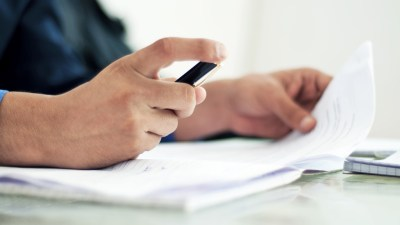 Man with ADHD fills out disability forms at desk
