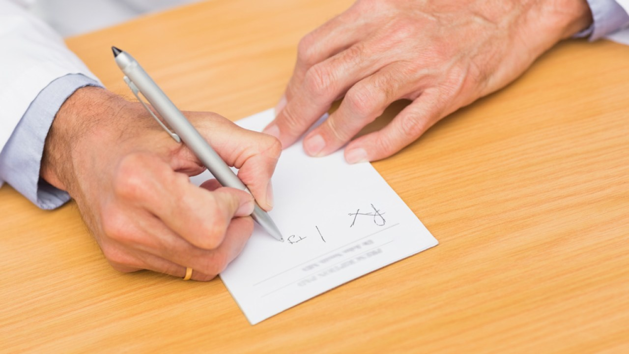 Doctor writing prescription for patient with ADHD