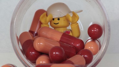 ADHD medication in jar with child's lego toy
