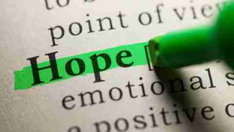 """A green highlighter coloring in the word """"Hope"""" in a dictionary. Hope can be a positive ADHD organizational tool."""