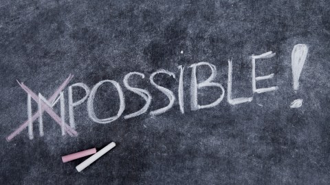 """The word impossible is written on a chalkboard, with the """"im"""" crossed out, because those with ADHD have perseverance."""
