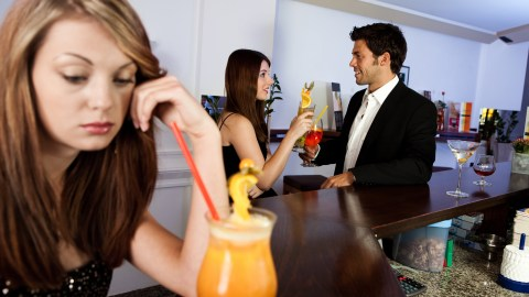 A woman experiences social anxiety at a party.