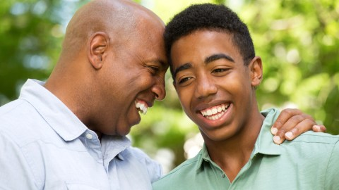 A father jokes with his son after he is diagnosed with ADHD