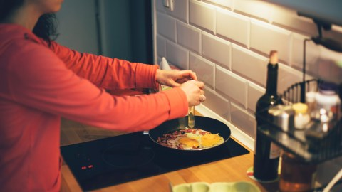 Woman with ADHD preparing dinner as a coping skill