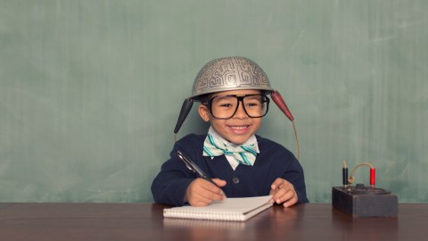 A boy with learning disabilities wears his thinking cap