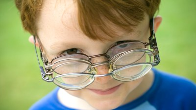 A boy with learning disabilities wears glasses.