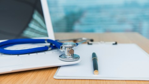 Doctor's laptop and stethoscope, important tools for accurate diagnoses.